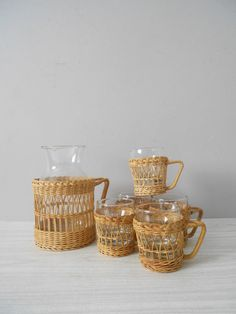 vintage wicker rattan pitcher and glass set / coffee mug / cup holders / inserts / caddy