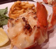 Broiled Lobster.Delicious lobster with lemon wedges and parsley.