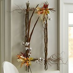 Be a bit unconventional and create a rectangle wreath this fall instead of a round one. Add feathers and cotton bolls for a trendy touch