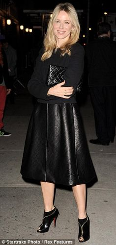 So glamorous:The 43-year-old was on trend in a leather skirt, a cropped blazer and open toe Louboutin ankle boots