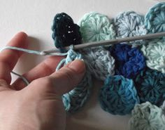 Hello. Today I'm going to share a short tutorial with you on how to crochet Sea Pennies! I'm using Rico Creative Cotton and a Number 4 hook for mine, but you can use any wool and hook t…