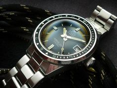 Ollech & Wajs Caribbean 1000 Ref. 702, ETA 2452 Auto, c1965-9 This is the earlier model from mid-late 60's, as the serial number confirms. It also has the 'flat' golden triangles on the bezel. …