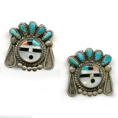 Vintage Zuni sterling  silver earrings with inlaid sun face, bezel set turquoise headdress and inlaid sun face.  Screw backs.