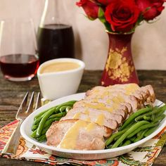 A recipe for Pork Roast with Peach Moscato Sauce. A boneless pork loin roast is seared then braised with peaches, Moscato wine, and onions.