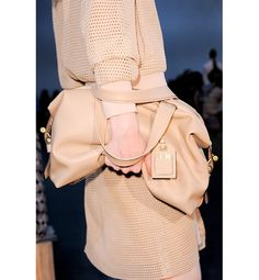 This year's popular purse silhouette? Slouchy handbags, as seen at Reed Krakoff. Whether you want a top-handle version or a casual cross-body style, look for a soft shape, particularly in a neutral hue that feels fresh for spring.