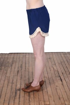 """Side view to the """"Trip the Light Fantastic"""" shorts, in royal blue."""