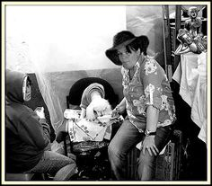 Mother at Flea - Market   by Daniel Gomez
