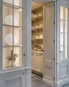 Pretty butlers pantry with soft blue doors and creamy interior