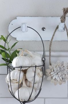 I like the idea of baskets from hooks to hold garlic and maybe other herbs
