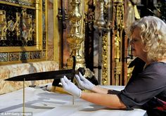 It included a rare outing for the former monarch's ancient sword, seen her sitting on the Abbey's altar