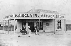 A family group outside P. Sinclair 's Alpaca Store in Ballarat. The woman and two young girls are dressed in crinolines. The store is weatherboard with goods displayed in the front window 1865 Discount Womens Clothing, Melbourne Victoria, Dresses Australia, Good Old, Young Women, Amazing Women, The Outsiders, Window, Group