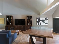 Traditional Family Room by Carolyn Reyes