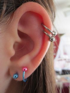 Double cartilage piercing, i like these how they are spaced out, the location, pluse i love the cute lobe earings :)