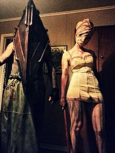 To sweeten the deal, here's myself and my bf as Pyramid Head.