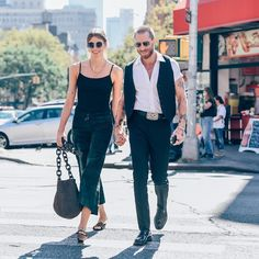 Cool couple. @heywomancom founder @veronikaheilbrunner pairs the suede patchwork pants with the haircalf sling bag from the Fall 2015 Calvin Klein Collection while out with boyfriend @justinoshea in New York City. Photographed by @tommyton.  Available now at the Calvin Klein Collection Madison Avenue flagship store in New York City. - Shop now for calvinklein > http://ift.tt/1Ja6lvu