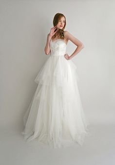 Our modern and unique ballgown, Simone combines a multi-layered skirt with a sweetheart strapless fully-boned bodice. The bust features lace and tulle
