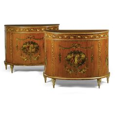 A pair of George III Style Painted Satinwood Demi-Lune Side Cabinets.