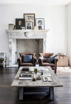 Leather chairs \\ layered portraits on mantel