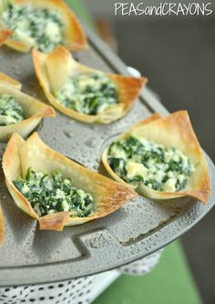 Shortcut Spanakopita recipe. You can also make these using your leftover hot spinach and artichoke dip. Includes a link to a recipe for tzatziki sauce for dipping these tasty treats.