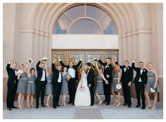 Cute photo of the wedding party with the bride and groom kissing