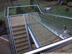 Frameless Glass Balustrade with side fixing handrail for external stairs.