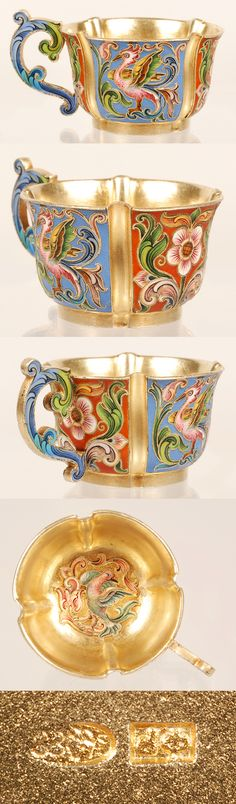 A Russian silver gilt and shaded cloisonne enamel charka, Feodor Ruckert, Moscow, 1896-1908. The charla, on a raised cylindrical base, decorated in panels of stylized multi-color scrolling foliate motifs against a red enamel ground and alternating panels of mythical griffins against a blue ground, the scrolling handle similarly worked, inside the cup a scroll and bird design.