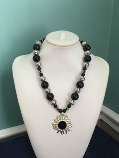 Black/silver sun pendant necklace by CoolBeadsDesign on Etsy
