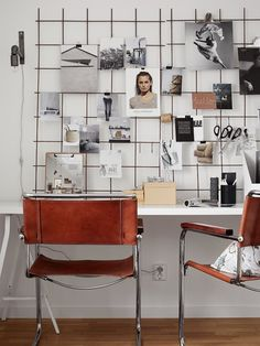 workspace with inspiring moodboard and metal+leather chairs