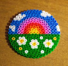 Awesome rainbow, flowers & grass coaster from perler /Hama beads Hama Beads Design, Diy Perler Beads, Perler Bead Art, Pearler Beads, Hama Beads Coasters, Hama Coaster, Melty Bead Patterns, Pearler Bead Patterns, Perler Patterns