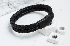 This double-wrap bracelet is crafted from 100% genuine leather, meaning it's as…