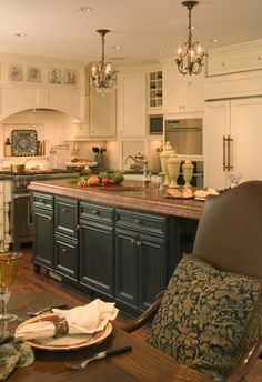 Cream and Dark Blue painted cabinets.  Butterfly Blue granite and Brazilian Cherry Hardwood on the Island. (Cultivate.com)