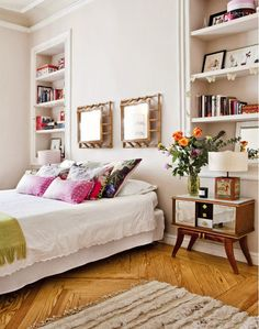 Feminine Bedroom With White Bedding and Bookcases