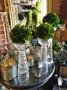 Also for the mantel are these glass stands holding round topiary balls | COCOCOZY: DECEMBER DO - TIME TO DECORATE