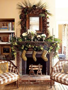 Fireplace mantle dressed for the holidays.  I love the use of vintage silver victory cups.