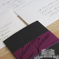 Custom wedding invitations. Sangria belly band and black pocket folder style with gorgeous calligraphy. Design by Couture Invitations.