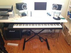 I am looking for digital piano stands that I would be able to pull out from under a desk.  Something like in the picture below.  Is there anything out there without having to go the custom-built route?  I've seen some studio desks with pull-out trays for keyboards, but I worry that an 88-k…