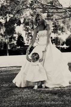 A Bride puts on her dress on her anniversary to take another photo shoot. This time, it's with her daughter. These pictures are so precious!
