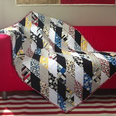 Photo by mengelbencsko {iHaus quilt} The black fabric really accents the other fabrics--great graphic appeal