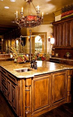 Tuscan Kitchen. Dark floors and tobacco glazed cabinets