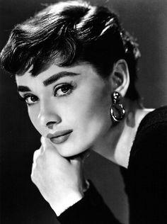 "Audrey Hepburn ""Sabrina"": Again - The haircut, gold loop earrings and black attire."