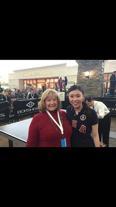 Cheryl with U.S. Olympic team member, Ariel Hsing, at ping pong match at Berkshire Hathaway event at Borsheim's in Omaha, Nebraska.
