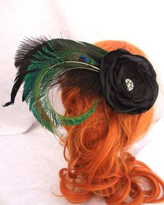 Black flower and peacock feather fascinator...looove it a lot! (RuthNoreDesigns on etsy)