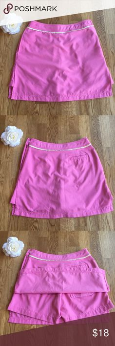 Lilly Pulitzer Pink Skort Super cute pink skort! No holes or stains and minimal signs of wear (see pics). Has a zipper and clasp on one side and one back pocket. Measurements posted in one of the pictures! Please ask any questions you may have! I want all buyers to be confident and happy in their purchase :) Smoke free home but I do have a dog! 🐶 Lilly Pulitzer Skirts