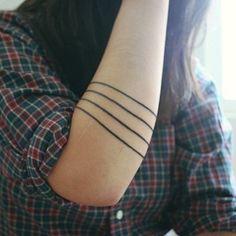Tathunting for some minimalistic tattoo designs.