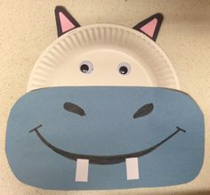 """Cute hippo craft idea to go with """"There's a hippopotamus on the roof eating cake"""". Easy to make for preschoolers and older toddlers. Get your kids involved!"""