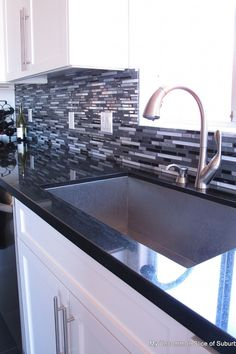 black granite with white cabinets