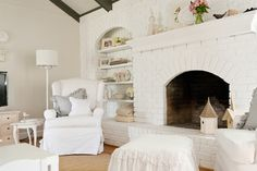 White painted fireplace / wall  Belgian Chic in a 1970's Ranch - traditional - living room - nashville - Kristie Barnett, The Decorologist