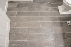Plank bathroom floor tiles - maybe to play off the colorful walls?