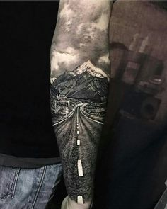 This tattoo is truly AMAZING! So artistic! Scenery tattoo. If I could be guaranteed a tattoo to turn out like this there'd be no going back. WOW Mountains tattoo, Open road tattoo. #IWish Baddass Tattoo