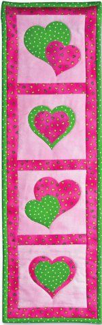 Applique Hearts Quilted Wall Display tutorial by AccuQuilt. Make this quilt wall banner in fun colors to decorate a little girl's room or in classic red and pink to dress up the house for Valentine's Day.